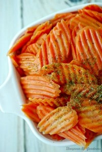 Dill glazed carrots in a white serving bowl