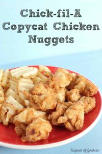 Chick-fil-A Copycat Chicken Nuggets with waffle fries on a plate