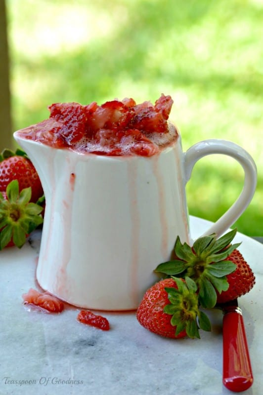 Easy Strawberry Topping in a white pitcher.