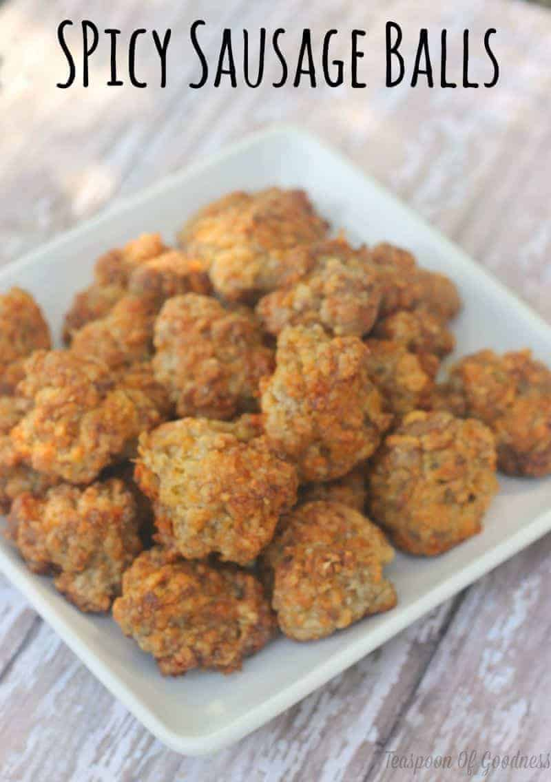 Snag this easy recipe for Spicy Cheese & Sausage Balls.  Perfect for a quick morning breakfast, road trip snack or school lunch ideas.  So easy they practically make themselves! ~ Teaspoon Of Goodness