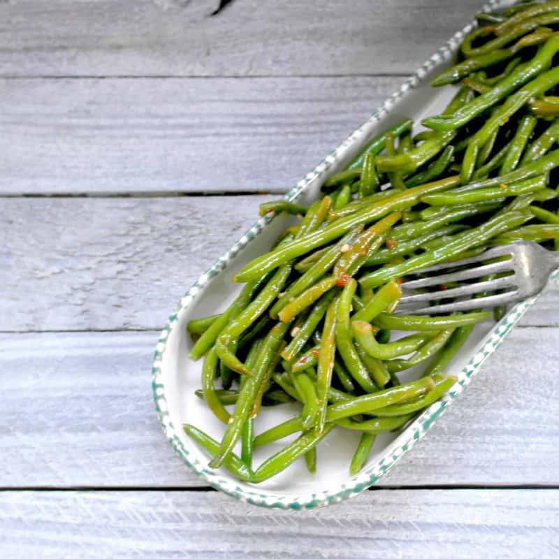 Italian Seasoned Green Beans In A Serving Dish