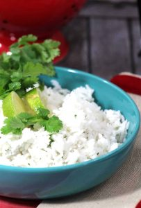 This Cilantro Lime Rice recipe is truly delicious, easy and of course a favorite side for tacos, enchiladas or simply grilled chicken or fish. - Teaspoon Of Goodness