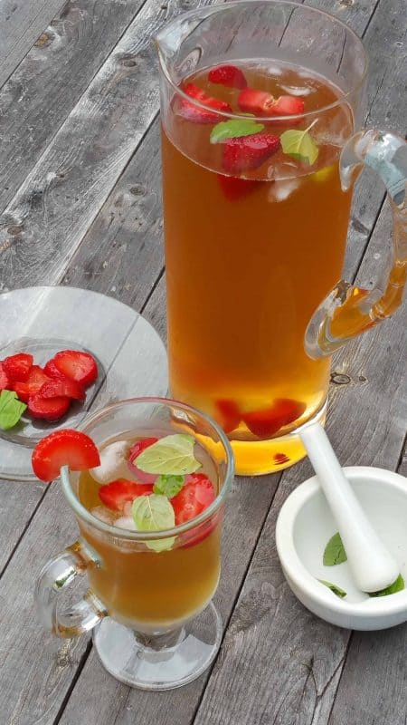Summer months bring about the need for a great cold drink on hot days, and our Strawberry Mint Iced Tea Recipe is the perfect choice. - Teaspoon of Goodness