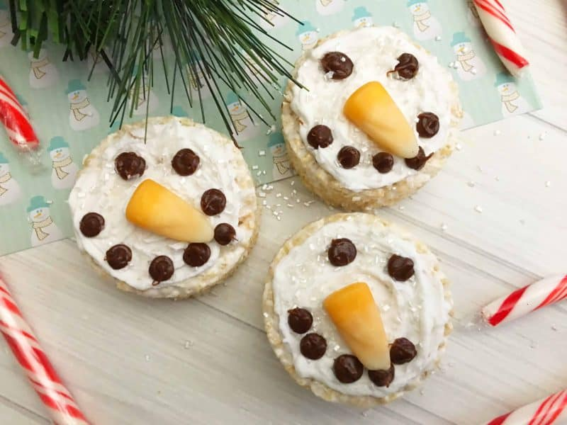 This Snowman Rice Cereal Treats recipe is a classic that takes a holiday shape and turns your favorite dessert into a cute idea everyone will grab on the dessert table. - Teaspoon of Goodness