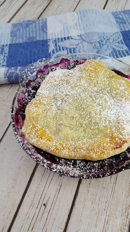 Rustic Blueberry Tart uncut in a pan made with puff pastry for a delicious fresh blueberry tarts recipe.