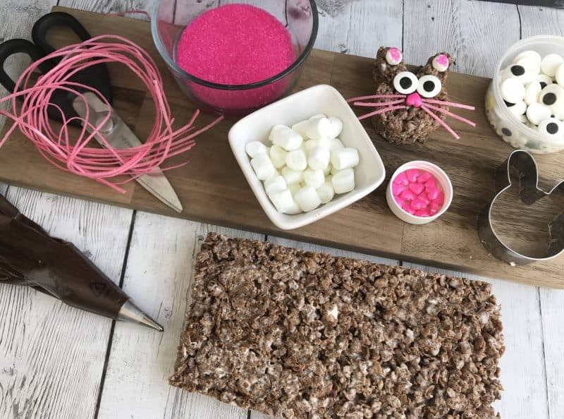 Ingredients needed to make Cocoa Krispie Easter treats shaped as bunnies.