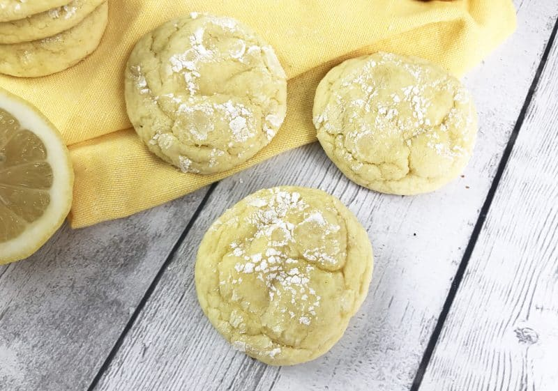 3 semi-homemade lemon cookies on a yellow and white background.