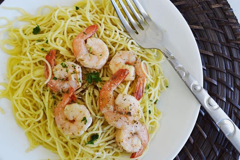 Shrimp scampi without wine on a plate ready to be served.