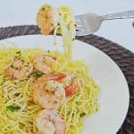 Shrimp Scampi pasta without white wine on a fork ready to be eaten.