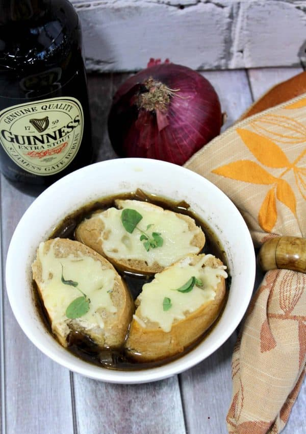 Crockpot French Onion Soup made with Guinness Beer and topped with toasted baguettes and Gruyere Cheese.