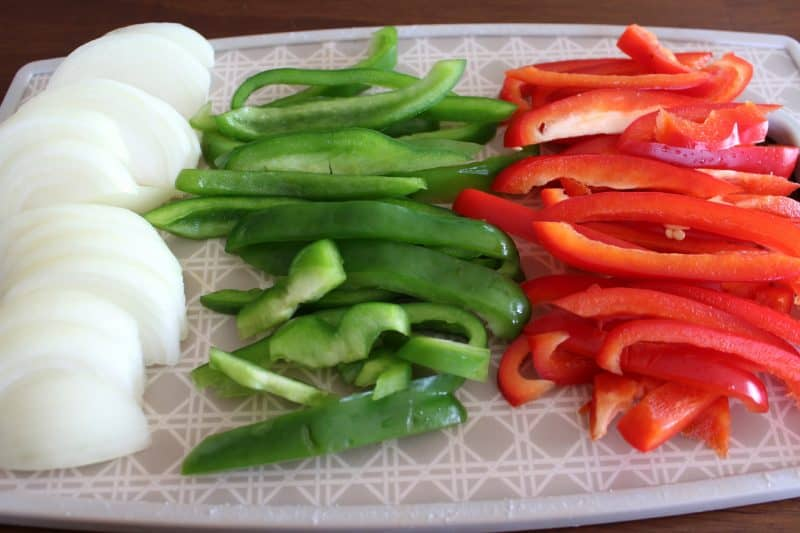Red pepper, green pepper and onions sliced ready for simple chicken fajitas.