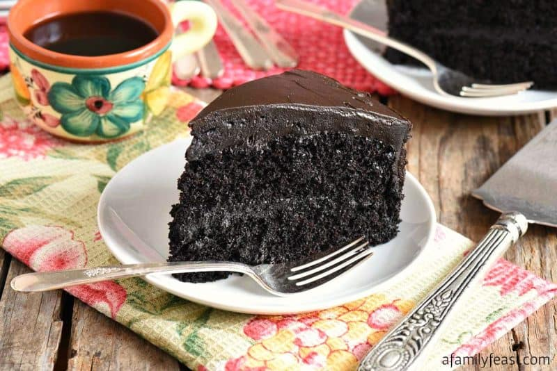 Double Chocolate Cake (black midnight cake) on a white plate for Mother's Day dessert.