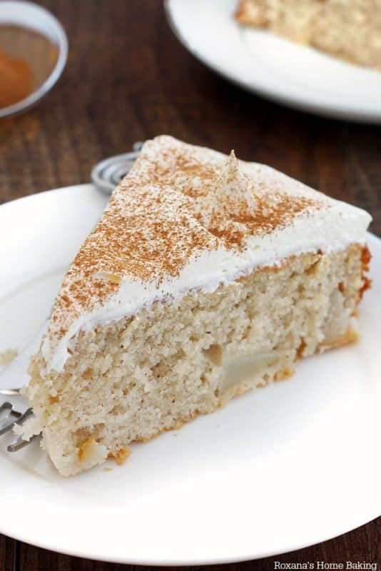 A slice of cinnamon pear cake on a white plate for a Mother's Day Brunch.