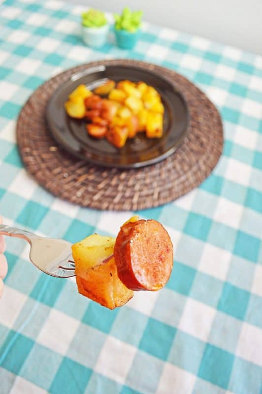 Sausage and potato on a silver fork