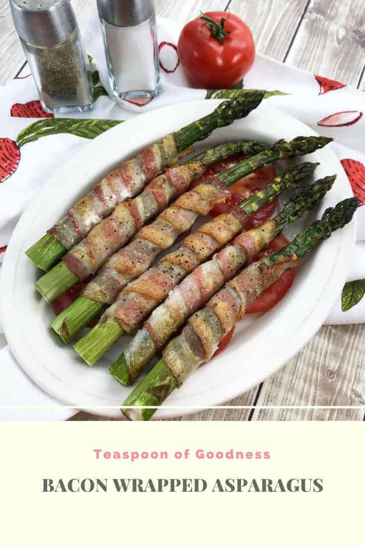 Oval white bowl with Asparagus wrapped bacon in the bowl