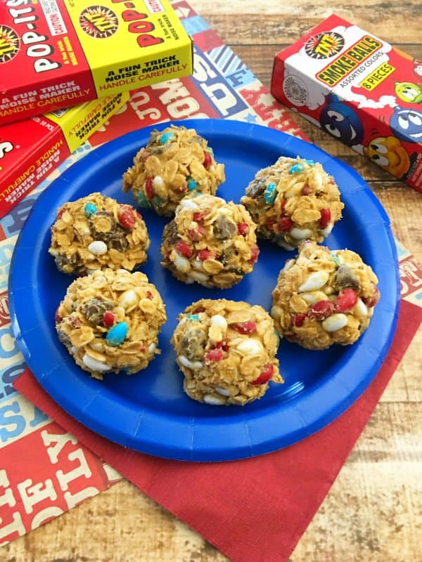 Chocolate chips, m&m's, oats, honey and peanut butter rolled into balls for a no bake 4th of July treat.