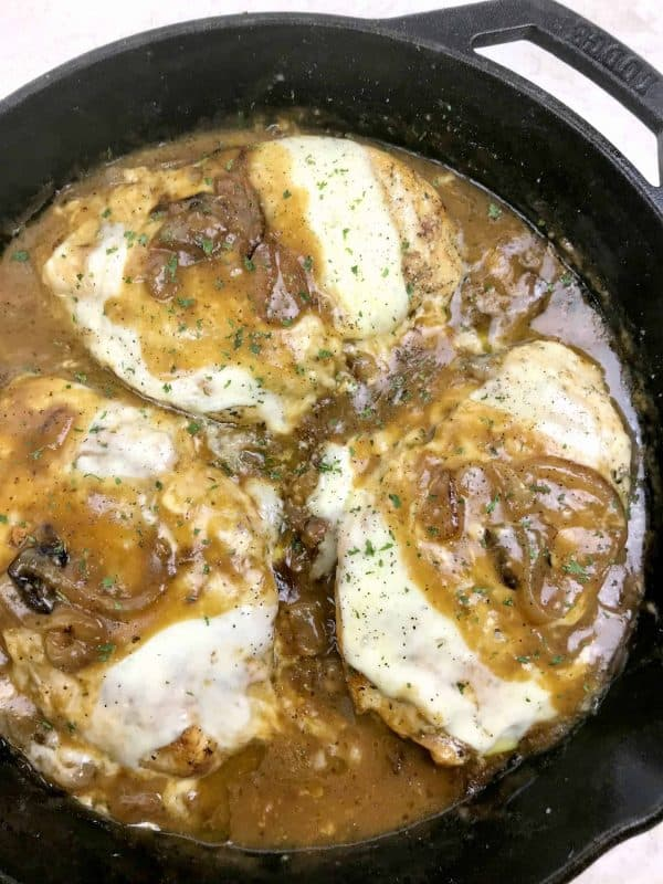 Easy french onion chicken skillet in a cast iron skillet.