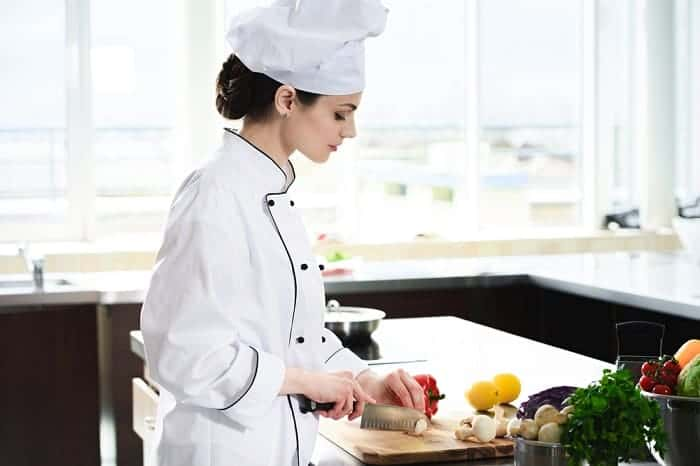 Woman chef cutting ingredients