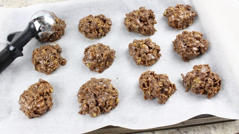 Nutella cornflake no bake treats resting on parchment paper to harden.