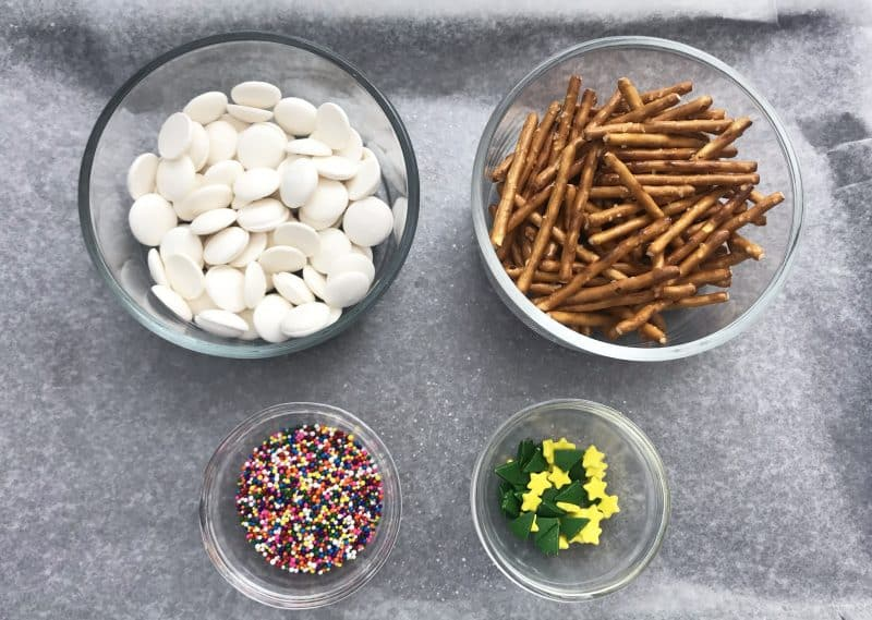 Ingredients needed to make candy coated pretzels that look like Christmas Treats.