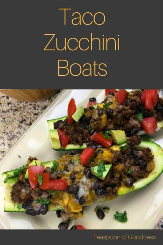 Zucchini with meat and vegetables in it on a white plate