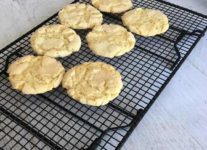 7 sugar cookies made from scratch sitting on a cooling rack.