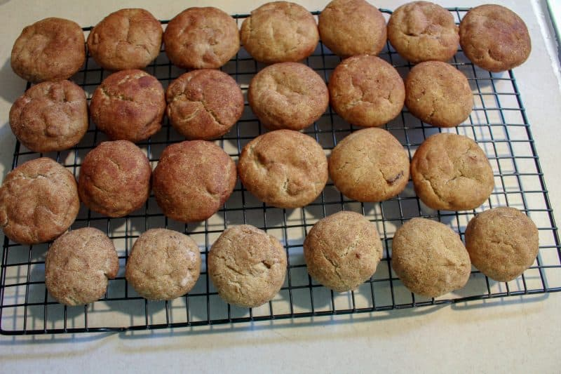 Baked snickerdoodle cookies with maple chips on a cooling rack.