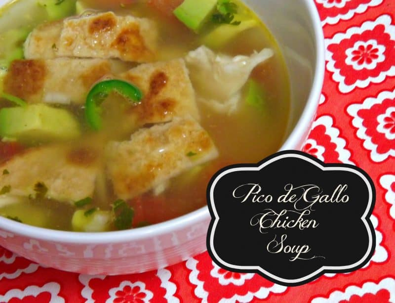 Chicken de Gallo Chicken Soup in a bowl with chunks of chicken and sliced jalapenos.