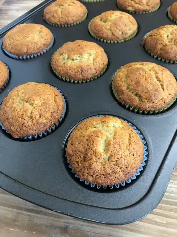 Banana muffins baked sitting in a muffin tin.