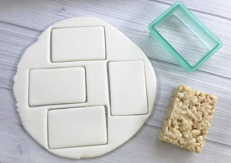 Premade rice crispy treats decorated like notebook paper.